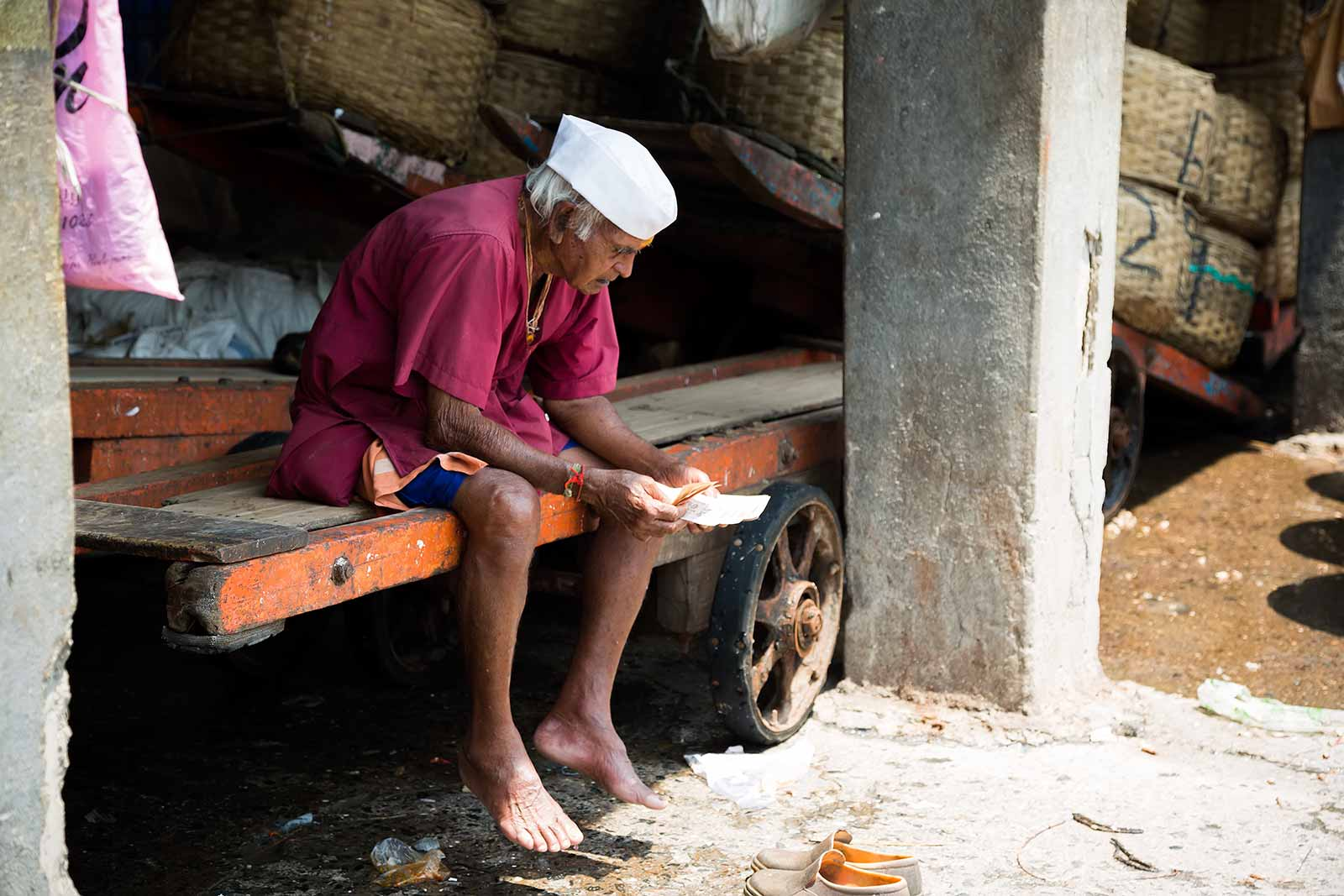 This wholesale trader at the Sassoon Docks counts his money after a busy morning.