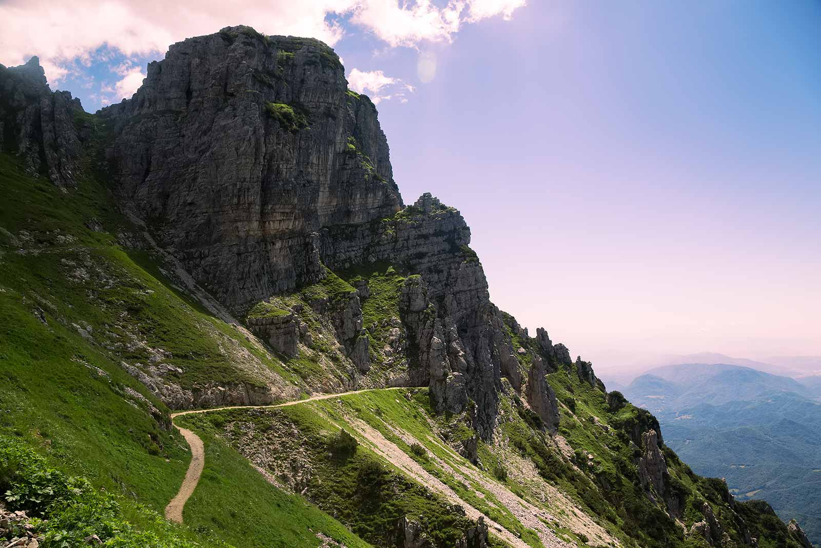 The Strada delle 52 Gallerie trail alternates between a dirt track and tunnels dug out of the mountain.