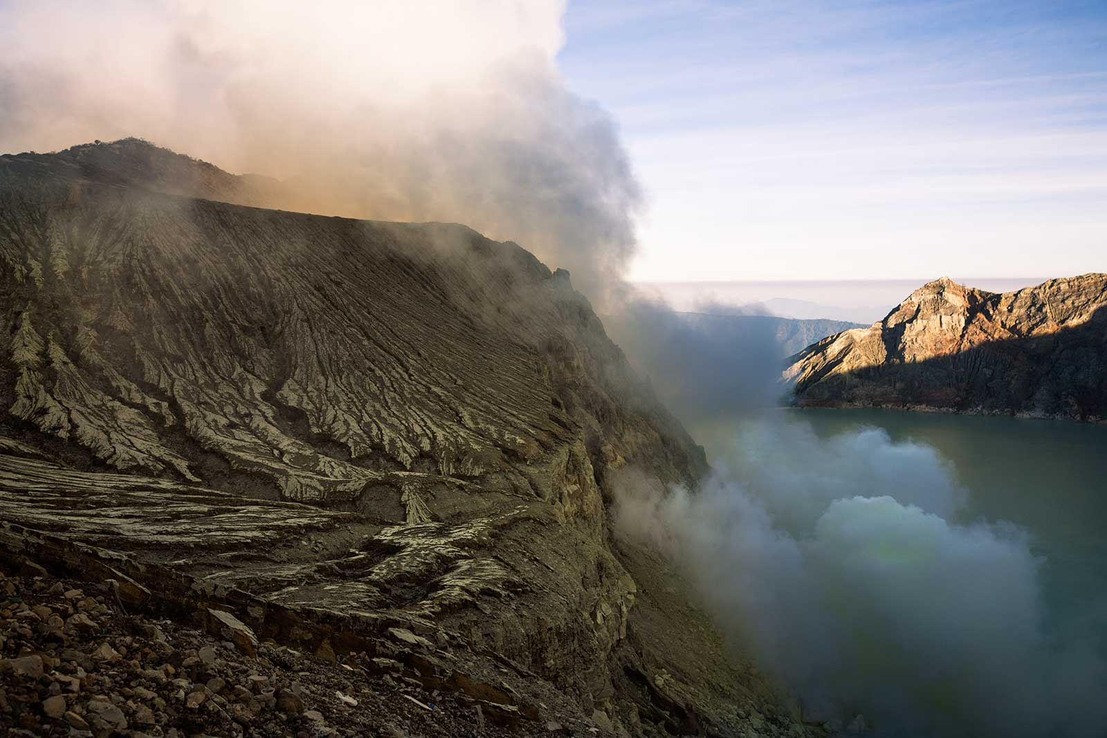 The miners inevitably inhale the toxic fumes at Kawah Ijen crater.
