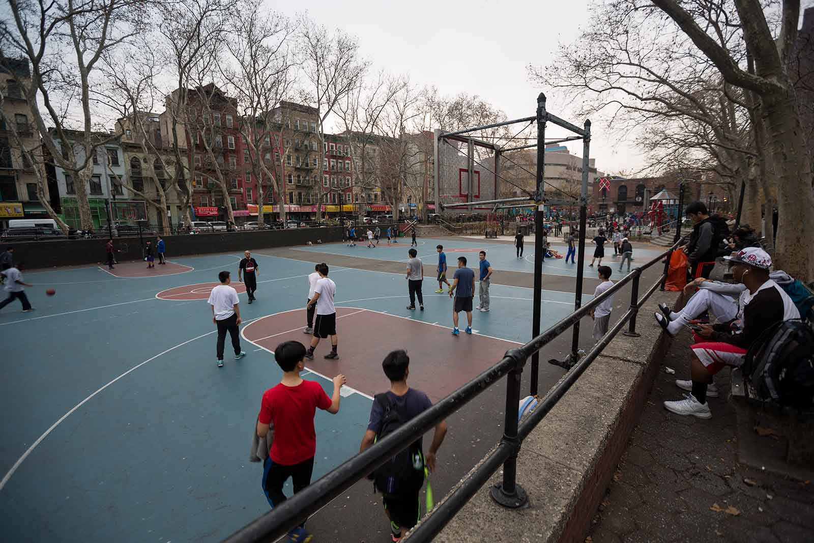 The basketball courts just off of Grand Street in Chinatown are the perfect spots for people-viewing.