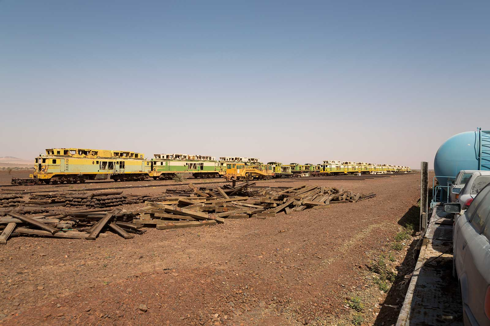 While the Iron Ore Train snakes its way through Mauritania, you'll come across wrecks from all sorts of vehicles - here, old Diesel locomotives that were once in use have been parked.