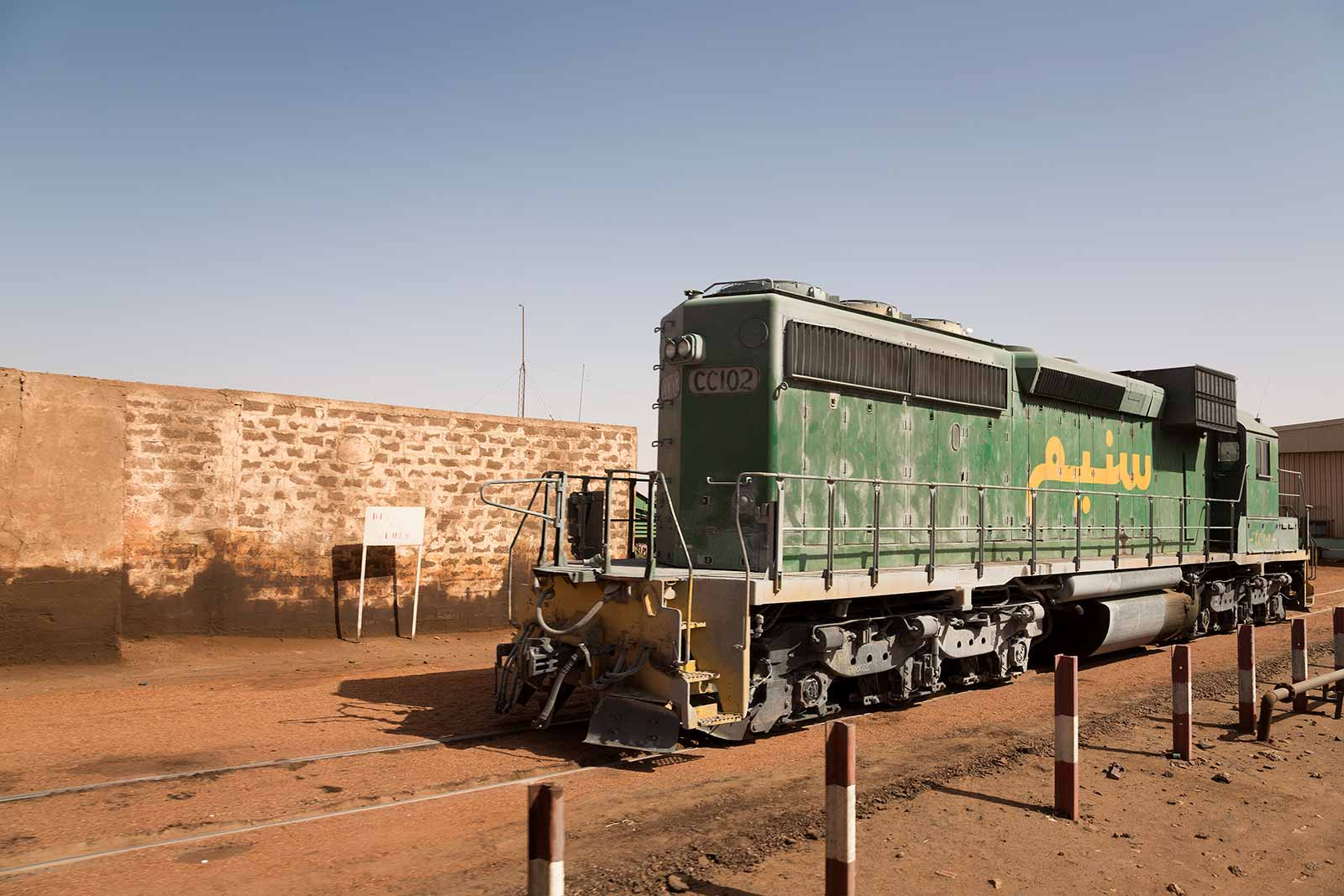 The bulk cargo train travels from the Sahara desert to the coast through dry nowhere to transport valuable minerals across Mauritania.