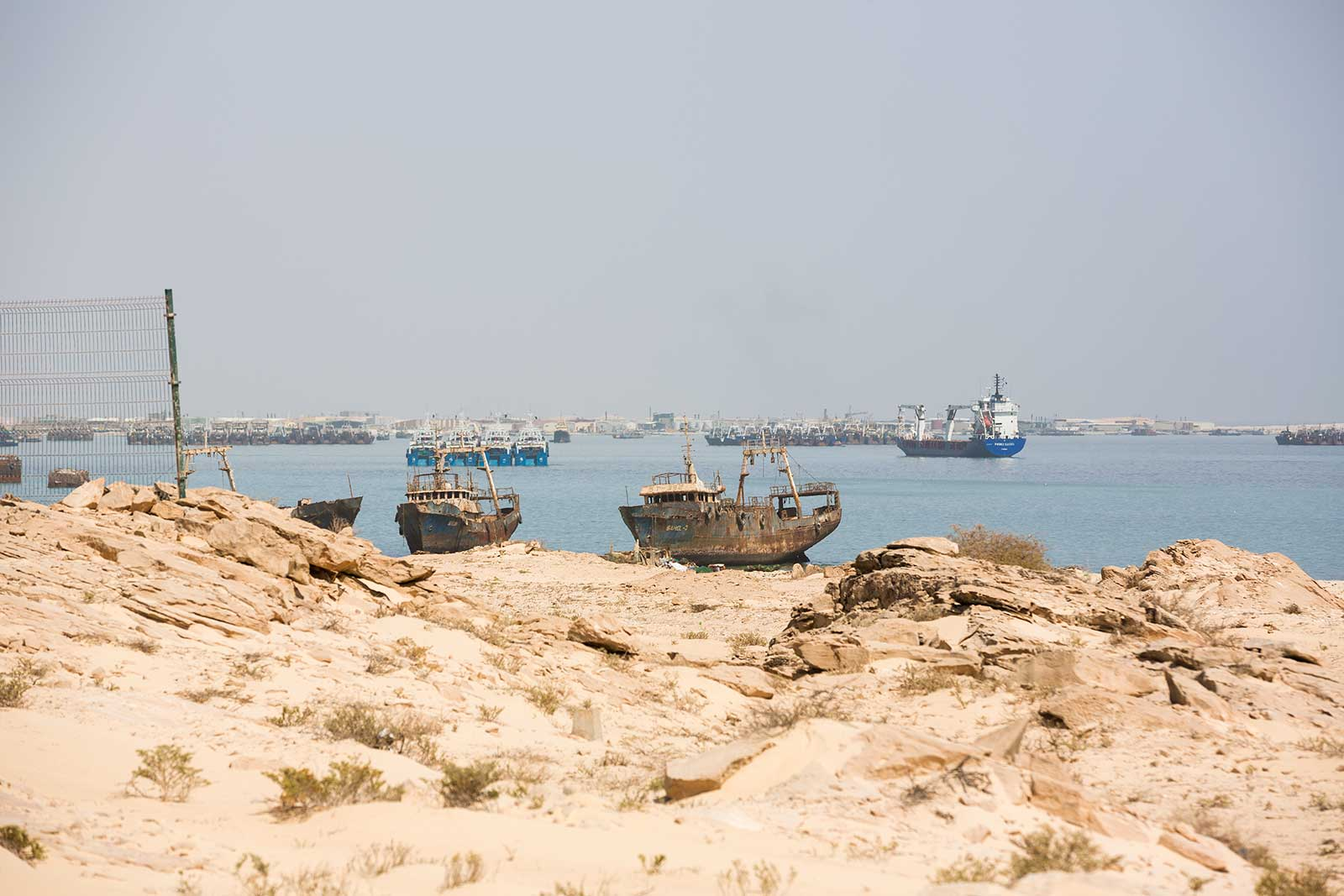 The view off the coast of Mauritania's Bay of Nouadhibou used to be spotted with rusting hulks in every direction. Today, this Ship Breaking Yard  is almost gone, due to an injection of capital from the Chinese.