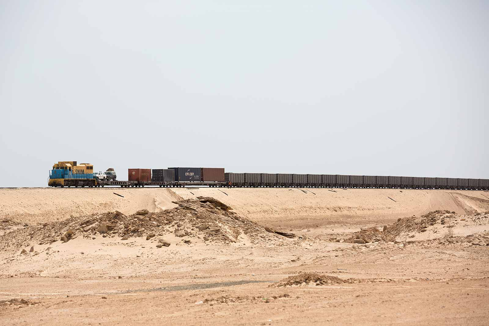 Two or three trains make a daily departure to pick up iron ore from a mine in Eastern Mauritania.