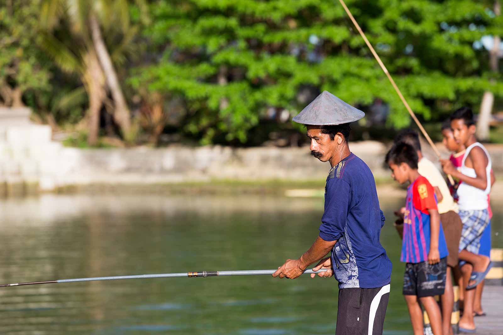 Maluku Islands: Fishermen along the jetty can be seen pretty much everywhere along the islands.